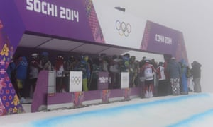 Men's snowboard cross athletes gather to hear the jury's decision to cancel the competition due to heavy fog during.