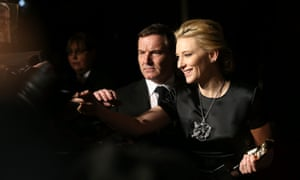 Cate Blanchett signs autographs as she arrives at the party. The ghost of Liz Taylor can just be made out in the background.