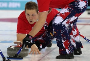 Splats: Norway's Christoffer Svae in a curling round robin match against Russia.
