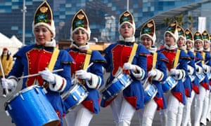 Women drummers march near medals plaza at the 2014 Sochi Winter Olympics.