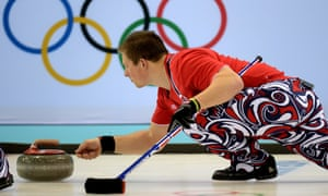 Norway's Christoffer Svae throws the stone during the men's curling round robin match against Denmark.