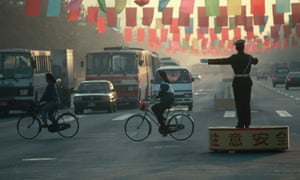 Beijing Traffic Policeman stands on a podium in the middle of the road directing traffic ca. October 1991 Beijing, China