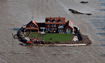 house with moat in flooded somerset