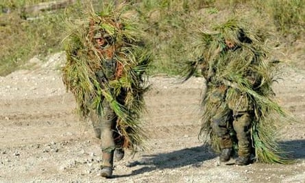 Two snipers wearing camouflage stealth camping