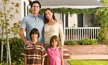 Portrait of family in front of house