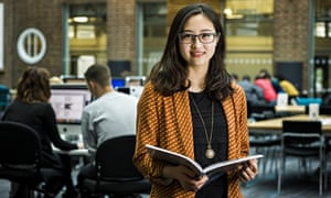 Kingston University: a student with an open book in the library