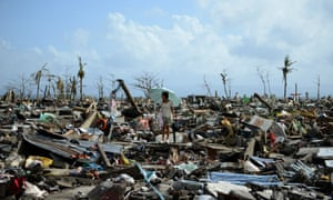 A survivor walks among the debris of houses destroyed by typhoon Haiyan in the eastern Philippine island of Leyte.