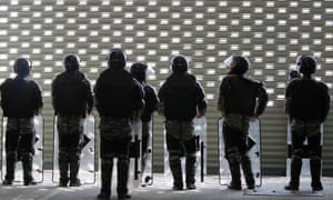 Soldiers stand guard at the temporary office of Thai prime minister, Yingluck Shinawatra, during a protest in Bangkok.