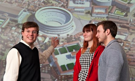 University of Reading: a lecturer points to a map as two students watch