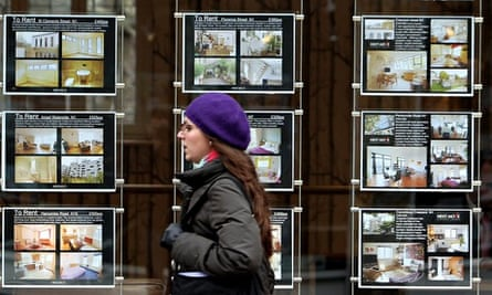 Woman passing estate agents