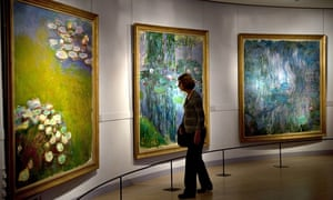 A visitor looks at Nympheas series by Claude Monet at the Marmottan museum