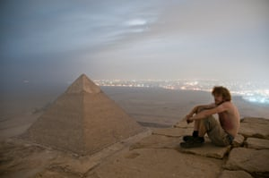 A photograph taken of her friend Max sat on the top of the Great Pyramid of Giza, which the pair scaled under cover of darkness - despite armed security guards patrolling the area in Giza, Egypt.