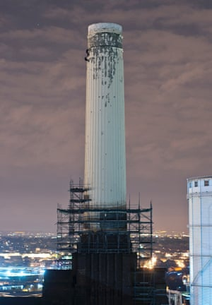 Friends scaling one of the Battersy Power Station chimneys in London.