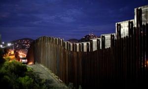 The border wall illuminated in Nogales, Arizona. mexico us