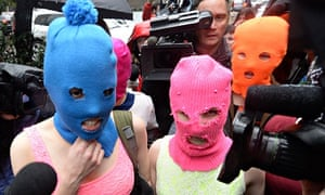 Pussy Riot wearing masks after being released from the police station