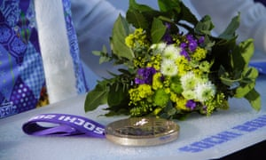 An Olympic medal sits on its tray before a presentation ceremony at the 2014 Sochi Winter Olympics.