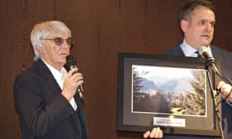 Formula One's Bernie Ecclestone helping at a charity auction in London on 7 February