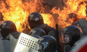 Riot policemen in flames clash with protesters in downtown Kiev.