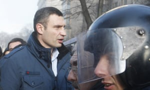 Vitali Klitschko (left) outside Ukraine's Parliament building in Kiev.
