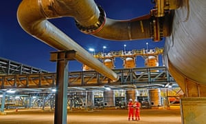 Workers at the BHP Billiton's Macedon gas plant during its opening in Onslow, Western Australia.