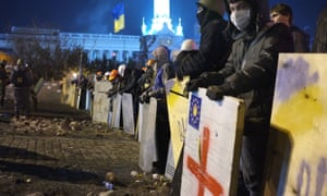 Anti-government protesters lining up earlier at their camp in Kiev's Independence Square.