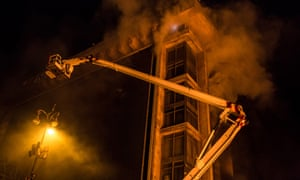A fire truck is used to rescue people from the upper floors of a burning Trade Unions Building, which has been used as the de facto headquarters for anti-government protesters, on February 19, 2014 in Kiev, Ukraine.