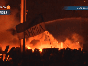 Police try to douse large fires in Independence Square, Kiev with water cannons.