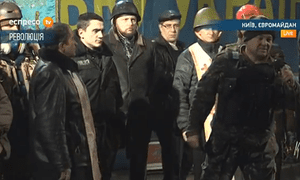 Protests leaders address the crowd in Independence Square, Kiev as violent clashes between demonstrators and police again flare up on Tuesday night.