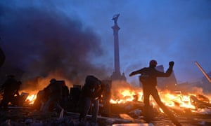 Protesters clash with police in Independence Square in Kiev