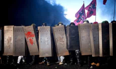 A wall of anti-government protesters during yesterday's clashes with police in Kiev.