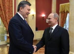 Russian President Vladimir Putin greets Ukrainian President Viktor Yanukovych earlier this month.