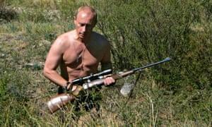 Vladimir Putin carries a hunting rifle