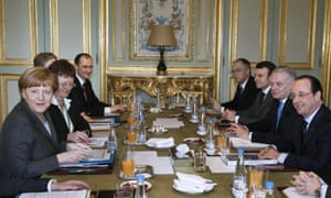 Merkel and Hollande hold talks at the Elysee Palace in Paris.