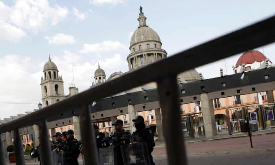 Mexican federal police stand guard outside the San Jose Cathedral in Toluca, Mexico.