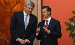 Mexico's President Enrique Pena Nieto and Canada's Prime Minister Stephen Harper at the National Palace in Mexico City.