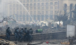 Special forces of the Ukrainian police clash with anti-government protesters on Independence Square in Kiev on Wednesday. At least 26 people have been killed and hundreds injured as violence once again flared between police and anti-government protesters, after several weeks of calm.