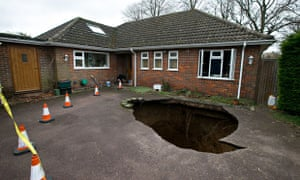A sinkhole which swallowed a car on a driveway in High Wycombe, Buckinghamshire
