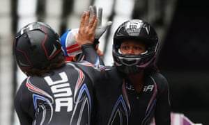 Elana Meyers (left) and Lauryn Williams of the United States team 1 celebrate after their run.