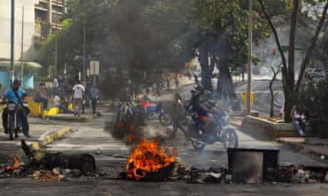 A flaming barricade erected by protesters in Caracas