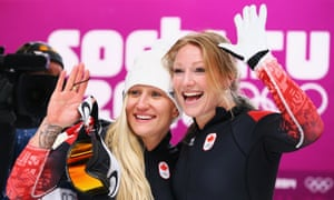 Kaillie Humphries and Heather Moyse of Canada team 1 celebrate after winning gold.