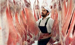 A butcher in an abattoir.