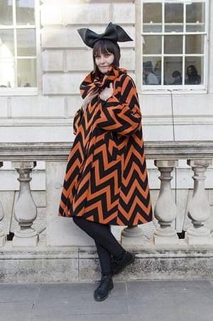 Older Models - Weekend : woman in orange and black coat and black hat