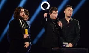 Arctic Monkeys accept British Group Award.