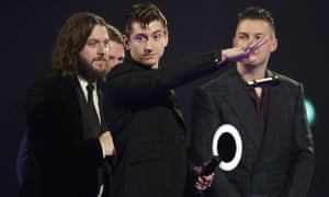 Alex Turner of the Arctic Monkeys collect their second award of the night for Best British Group.
