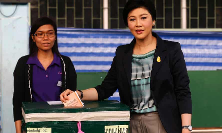 Yingluck Shinawatra casts her ballot at a polling station in Bangkok.