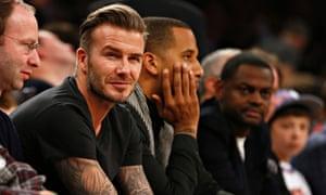 David Beckham watches the Miami Heat v New York Knicks basketball game