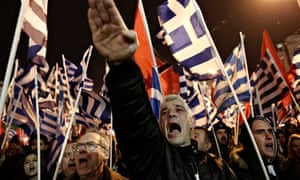 A Golden Dawn supporter raises his hand in a Nazi salute during a rally in Athens.