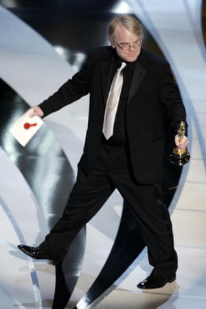 Philip Seymour Hoffman accepts his Oscar for best actor at the Academy Awards in 2006