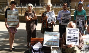 Refugee Action Coalition protesters gather outside the law courts in Sydney.