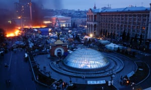 Smoke rises above burning barricades as dawn breaks on Kiev's Independence Square on Thursday.